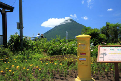 A yellow mailbox near the southernmost station on the Japan Railroad named Nishi Ooyama station.